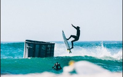 Jordy Smith airs into a floating trash can