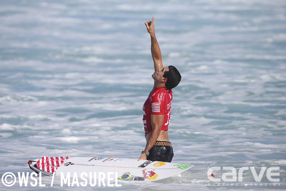 Adriano De Souza of Brasil (pictured) points to the sky after his Quarterfinal victory at the Buillabong Pipe Masters on Thursday December 17, 2015.