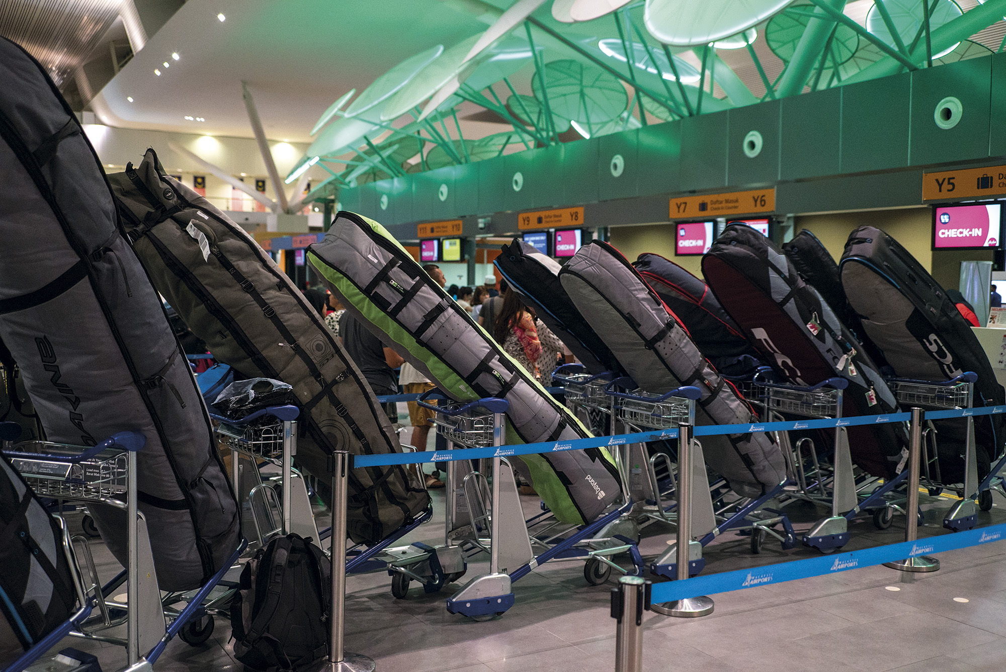 surfers airline baggage fees