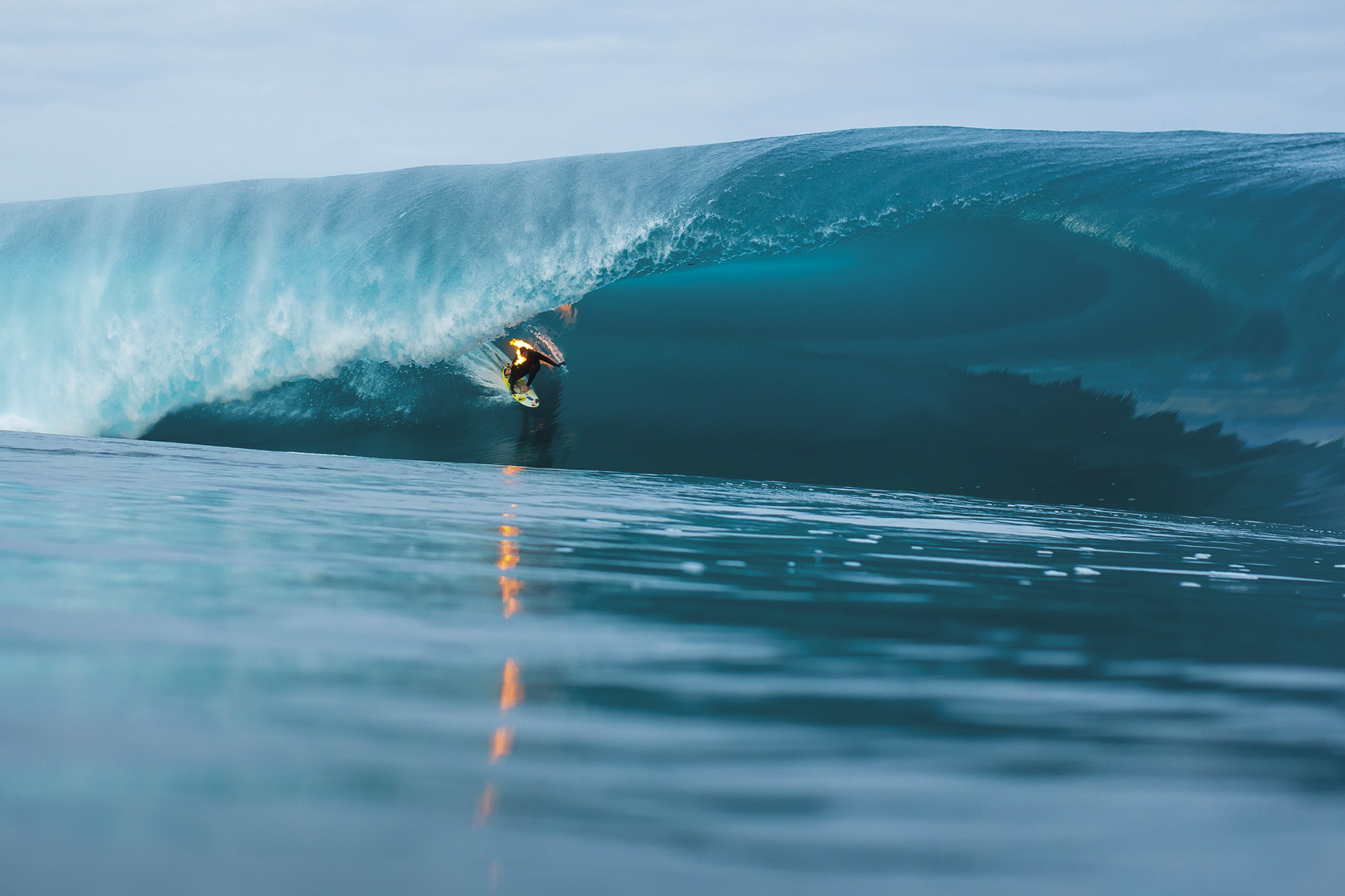 Jamie O'Brien surfs a barrel whilst lit on fire, at Teahupoo, Tahiti on 22 July, 2015. // Ben Thouard / Red Bull Content Pool // P-20150723-00226 // Usage for editorial use only // Please go to www.redbullcontentpool.com for further information. //