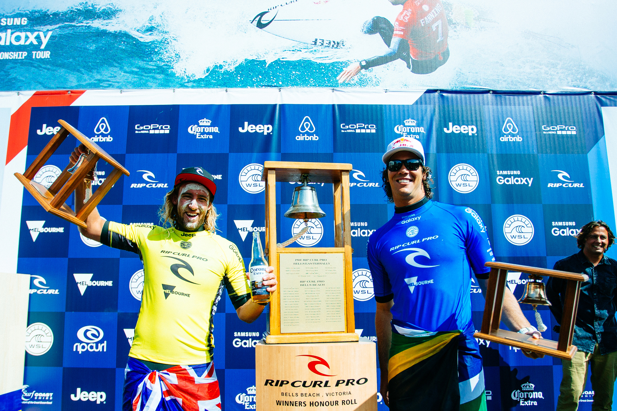 Rip Curl Pro Bells Beach champion Matt Wilkinson of Australia (pictured yellow) and runner up Jordy Smith of South Africa (blue) celebrate during prizegiving at the Rip Curl Pro Bells Beach on Sunday April 3, 2016. Matt Wilkinson of Australia (pictured) hoists his bell after winning the Rip Curl Pro Bells Beach on Sunday April 3, 2016. PHOTO: © WSL/ Sloane SOCIAL: @wsl @edsloanephoto This image is the copyright of the World Surf League and is provided royalty free for editorial use only, in all media now known or hereafter created. No commercial rights granted. Sale or license of the images is prohibited. This image is a factually accurate rendering of what it depicts and has not been modified or augmented except for standard cropping and toning. ALL RIGHTS RESERVED.