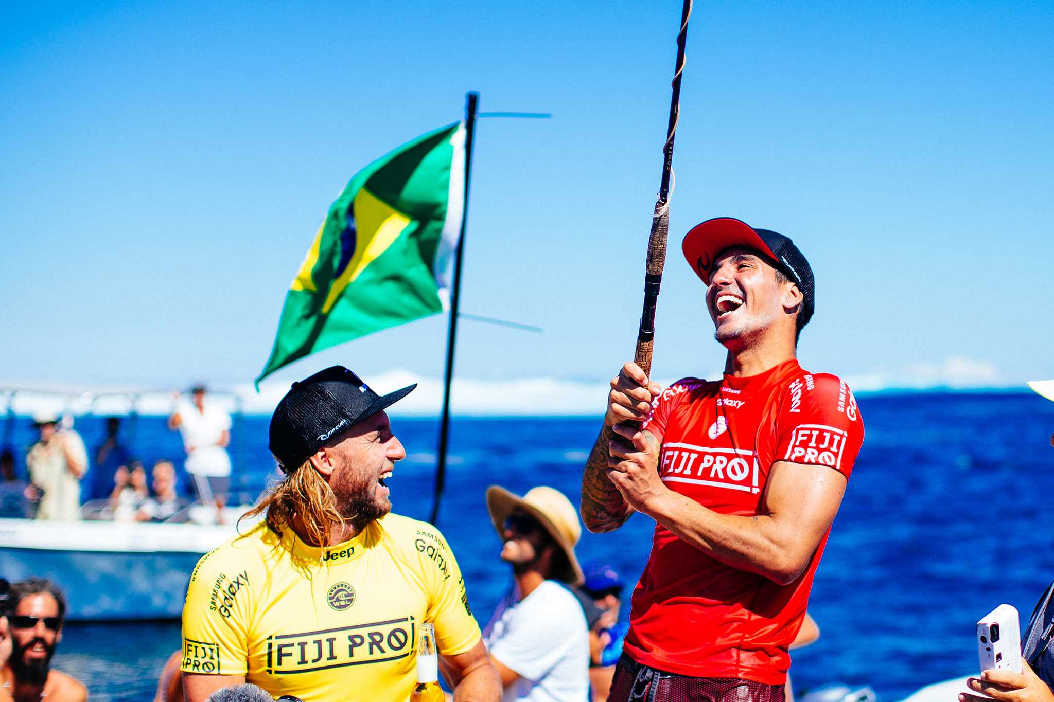 Gabriel Medina of Brasil (pictured) celebrates his victory alongside runner and his opponent Matt Wilkinson of Australia (yellow) at the Fiji Pro at Cloudbreak on Friday June 17, 2016.  PHOTO: © WSL/ Sloane @edsloanephoto This image is the copyright of  the World Surf League and is provided royalty free for editorial use only, in all media now known or hereafter created. No commercial rights granted. Sale or license of the images is prohibited. This image is a factually accurate rendering of what it depicts and has not been modified or augmented except for standard cropping and toning. ALL RIGHTS RESERVED.