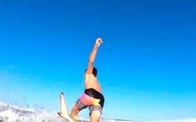Boy knocked off surfboard by shark